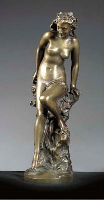 A bronze figure of a female 'L
