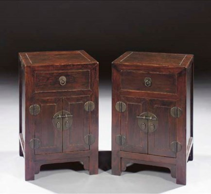 A pair of black lacquered side