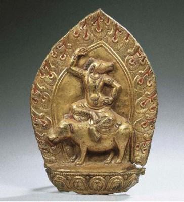 a tibetan gilt-copper repousse