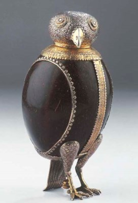 A parcel-gilt and silver mount