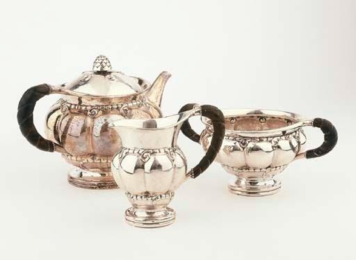 A Danish hammered silver tea s