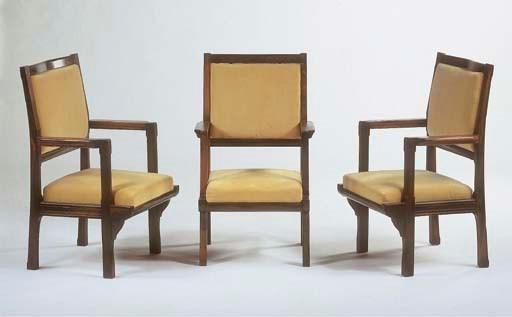Three rosewood armchairs