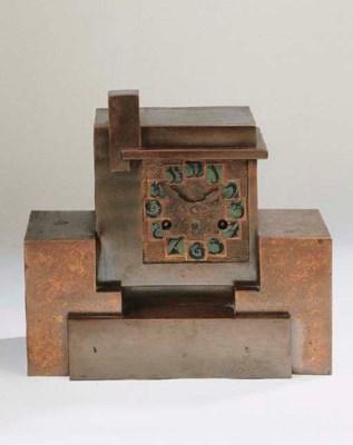 A patinated copper mantle cloc