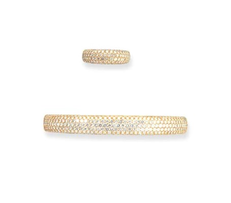 A DIAMOND BANGLE WITH RING