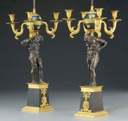 A pair of green-painted, gilt