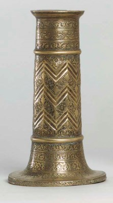 A SAFAVID ENGRAVED BRASS TORCH
