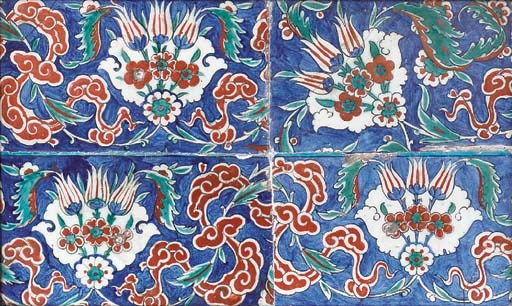 FOUR IZNIK POTTERY BORDER TILE