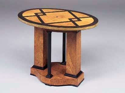 An inlaid and ebonised maple a