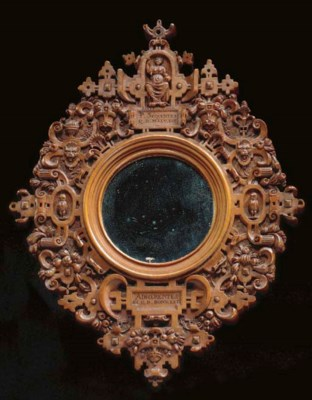 A CARVED PEARWOOD MIRROR