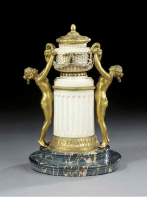 A LOUIS XVI ORMOLU AND IVORY C