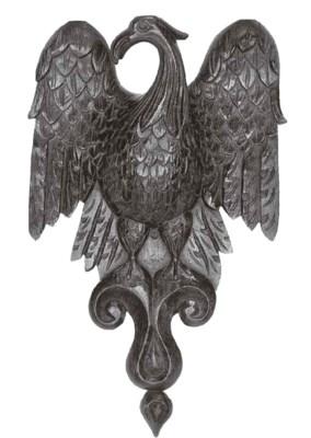 A carved oak wall applique, En