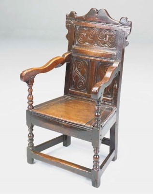 AN OAK PANEL BACK ARMCHAIR, SO