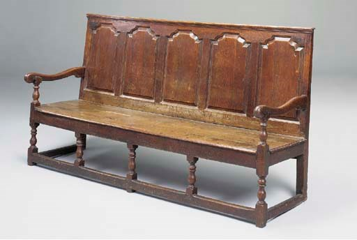 A LARGE OAK SETTLE, NORTH COUN