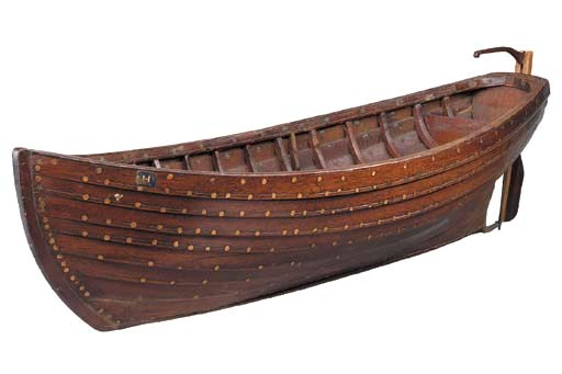 A mahogany model of a rowing b