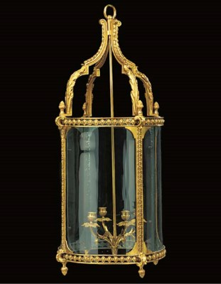 A gilt metal and glass cylindr