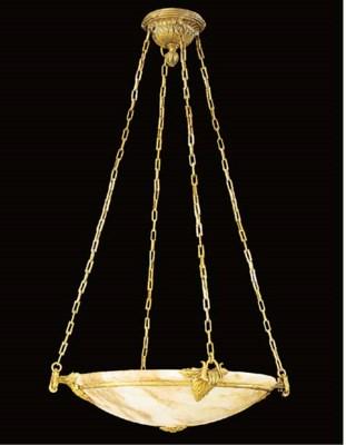 A gilt metal mounted alabaster