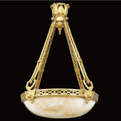 A gilt metal and alabaster mou