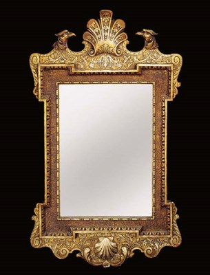 A SILVERED AND GILTWOOD MIRROR