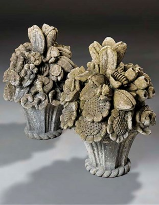 A pair of limestone floral bou