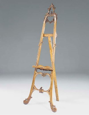 A French carved walnut easel,