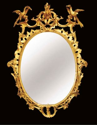 A GILTWOOD OVAL MIRROR, 19TH C
