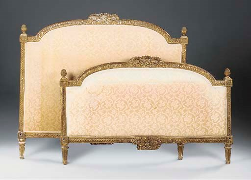 A FRENCH CARVED GILTWOOD BED,