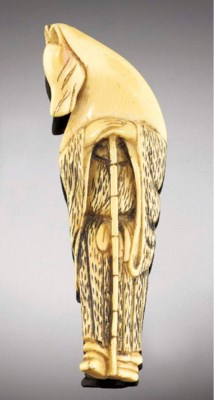 An ivory netsuke of a fox-prie