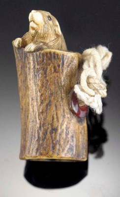 A stained ivory netsuke of a r