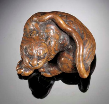 A wood netsuke of a tiger Circ