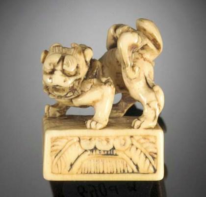 An ivory netsuke of a buddhist