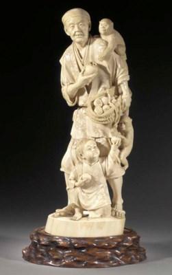 A large ivory okimono of a fru