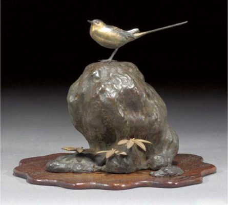 A bronze okimono of a bird on