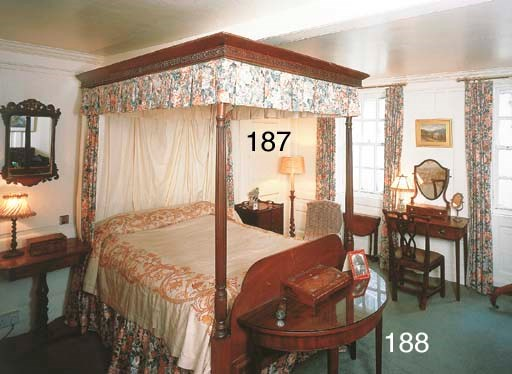 A mahogany four-poster bed