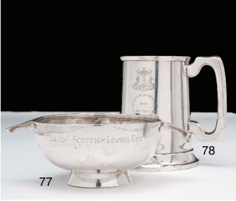 A silver tankard, the front in