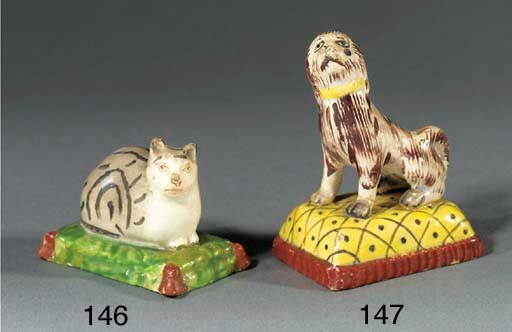 A pearlware model of a tabby c