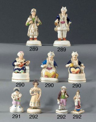Two porcelain penholders of a