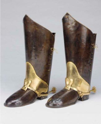 A pair of patinated and gilt m