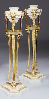 A PAIR OF GILT METAL AND CREAM