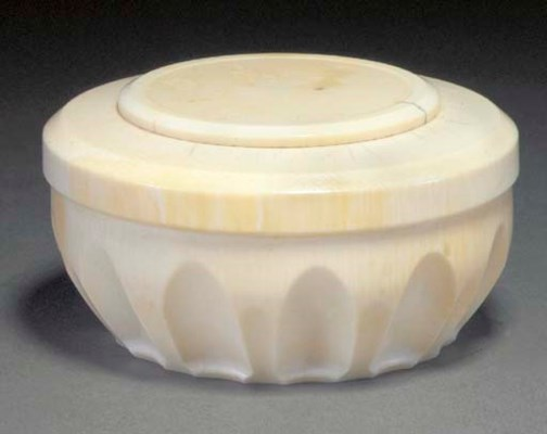 AN IVORY BOX AND COVER
