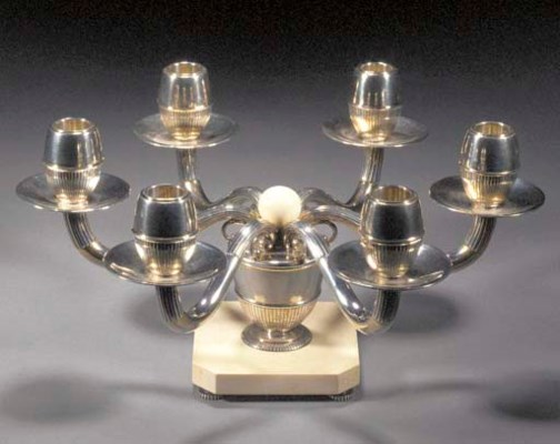 A WHITE METAL AND IVORY CANDEL