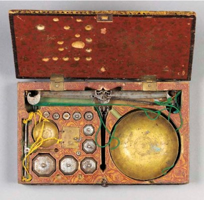 A Persian boxed weights and sc