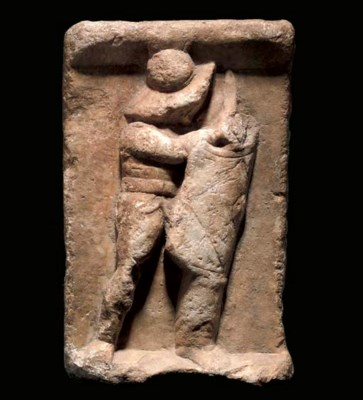 A ROMAN MARBLE RELIEF OF A MUR
