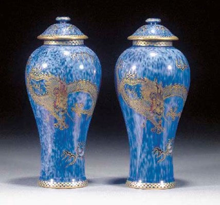 A pair of lustre vases and cov