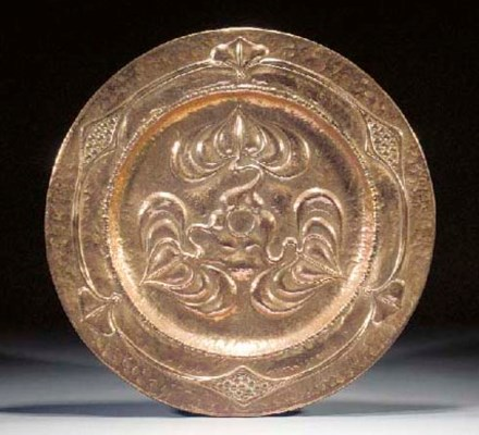 An Art Nouveau copper charger