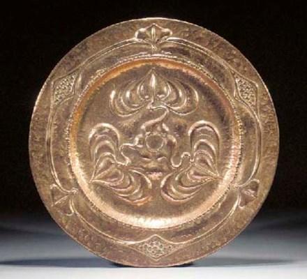 An Art Nouveau copper charger