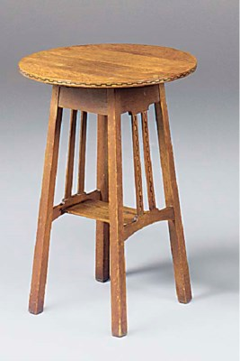 AN OAK OCCASIONAL TABLE In the