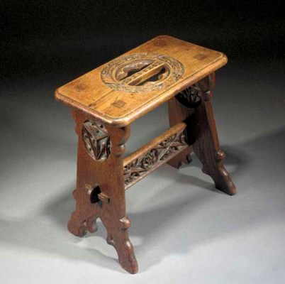 A GOTHIC REVIVAL OAK STOOL