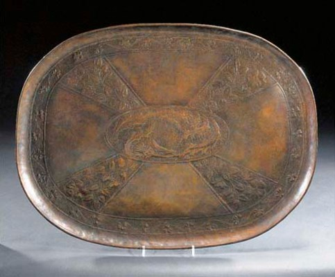 A PATINATED COPPER TRAY IN THE