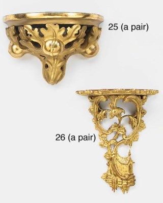 A pair of carved gilt wood wal