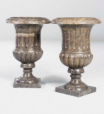 A pair of grey marble campana